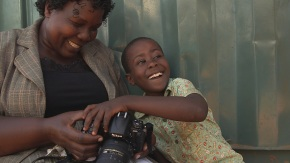 Gladys Kalibbala, a Ugandan journalist with a young boy. This image appeared in the documentary Misconception, which featured Kalibbala's writing for New Vision. |Photo: Nathan Goldon